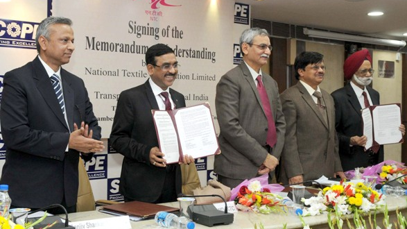 The Secretary, Ministry of Textiles, Dr. S.K. Panda and the Central Vigilance Commissioner, Shri K.V. Chowdary witnessing the signing ceremony of a Memorandum of Understanding between National Textile Corporation Limited (NTC Ltd.) and Transparency International India (TII), in New Delhi on December 03, 2015.