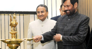 """The Union Minister for Consumer Affairs, Food and Public Distribution, Shri Ram Vilas Paswan lighting the lamp at the National Consumer Day celebrations with the theme """"Safe & Healthy Food: Combating Food Adulteration"""", in New Delhi on December 22, 2015. The President, NCDRC, Justice Shri D.K Jain is also seen."""