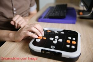 Visually impaired person using audio book player